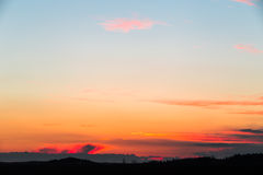 Sunset. On a field with colorful clouds Stock Images