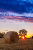 Sunset field, tree and hay bale. In Hungary- this photo made by HDR technic Stock Photo