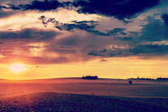 Sunset in fields in summer Stock Photography