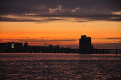 Sunset. Fiery sunset city on water Stock Photo