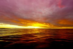 Sunset at Fiji. WS: Pink & purple sunset over a calm sea in Fiji Stock Photography