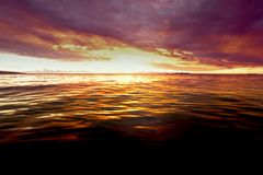 Sunset at Fiji. WS: Pink & purple sunset over a calm sea in Fiji Royalty Free Stock Photo