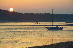 Sunset at Findhorn. Sunset at Findhorn with a yacht and catamaran moored in the bay Royalty Free Stock Photos