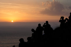 Sunset from Finisterre lighthouse, Galicia, Spain. Group of tourists photographing the sunset from Finisterre lighthouse, Galicia, Spain royalty free stock photos