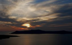 Sunset from Fira. Colorful clouds from Fira`s sunset, Santorini Greece stock photo