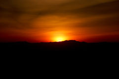 Sunset silhouette of western mountain Royalty Free Stock Photos