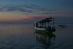 Sunset with fisher boat and still water on Gili Air Island, Indo Royalty Free Stock Image