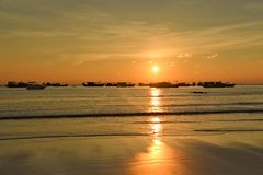 Sunset with fisher boats Ngwe Saung Beach Myanmar stock photos