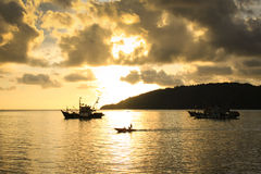 Sunset with Fisherman Boats at background Royalty Free Stock Photo