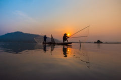 Sunset fisherman Fishing Stock Images