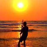 Sunset fisherman Royalty Free Stock Images