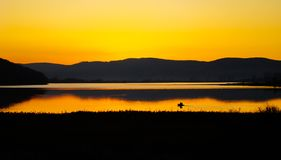 Sunset and fisherman royalty free stock photography