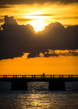 Sunset with a fisherman Royalty Free Stock Photo