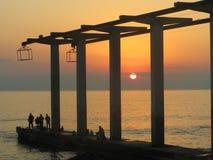 Sunset & Fishermen. Fishermen at the dock of Adler, South of Russia Stock Photos