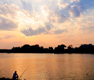 Sunset fishing Stock Photo