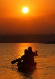 Sunset. Fishing by boat across the lake as the sun began to sink in Boyolali, Central Java, Indonesia Stock Photo