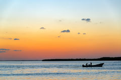 Sunset and Fishing Boat Stock Photo