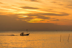 Sunset with fishing boat Stock Photography