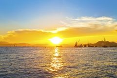 Sunset with fishing boats background Stock Photography