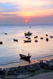 Sunset. Fishing boats in harbor. Stock Photography