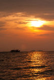 Sunset on fishing boats in Stock Photo
