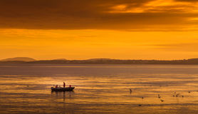 Sunset Fishing. Fishing during the sunset in Norway Royalty Free Stock Photo