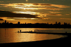 Sunset Fishing at Point Walter, Swan River, Perth. People enjoy the setting winter sun to fish on a sandbank on the Swan River in Perth Western Australia Royalty Free Stock Photos