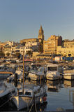 Sunset at the fishing port and village of Palamos, Girona, Catal Royalty Free Stock Photo