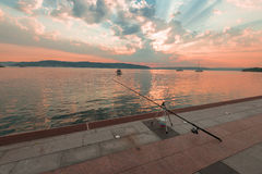 Sunset  with fishing rods near cafe,  Marmara Sea, Canakkale Stock Photos