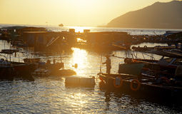 Sunset at fishing village Royalty Free Stock Photography