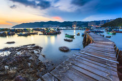Sunset at fishing village wooden bridge Royalty Free Stock Photos