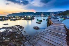 Sunset at fishing village wooden bridge Royalty Free Stock Photos