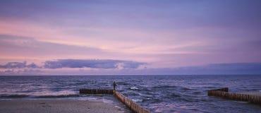 Sunset fisshing on breakwater Stock Images
