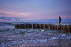 Sunset fisshing on breakwater Stock Image