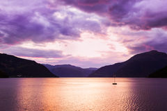 Sunset in fjord Hardanger Norway Stock Images