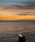 Sunset and flame Stock Photos