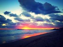Sunset flare. A spectacular sunset over the beach Stock Photos