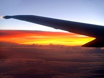 Sunset flight. Sunset and aircraft wing Royalty Free Stock Photography