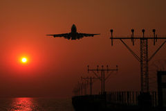 Sunset Flight. Take a photo at airport of Hong Kong Stock Photo