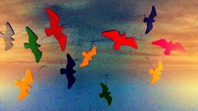 Sunset flight. Fake Birds in flight with sunset colors Royalty Free Stock Image