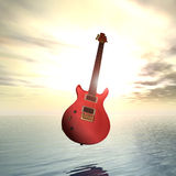 Sunset floating electric guitar Royalty Free Stock Photos