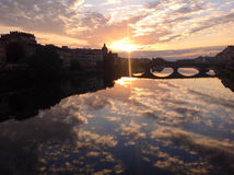 Sunset in Florence with beautiful sky reflections in Arno Royalty Free Stock Photography