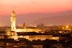 Sunset in Florence with a view of the Palazzo Vecchio. And the medieval city Royalty Free Stock Images