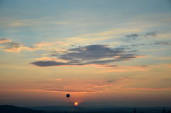 Sunset and flying balloon Stock Image