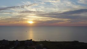 Sunset flying with drone forward. Aerial view. 4k. Sunset, flying with drone above ocean and city forward in Rodanthe, NC, USA stock footage