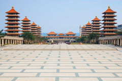 Sunset at Fo Guang Shan buddist temple of Kaohsiung, Taiwan with many tourists walking by Royalty Free Stock Photography