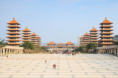 Sunset at Fo Guang Shan buddist temple of Kaohsiung, Taiwan with many tourists walking by. Stock Image