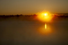 Sunset and fog Stock Image