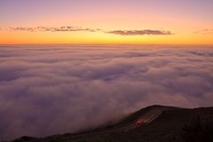 Sunset and fog. Sunset at Marin Headlands and fog covering ocean Stock Photo