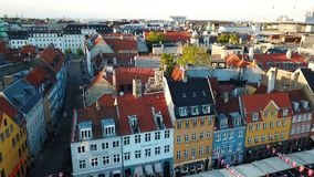 Sunset footage video from Copenhagen, Denmark. Nyhavn New Harbour canal and entertainment district. Aerial Video footage